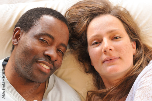 Mixed race couple enjoying each other