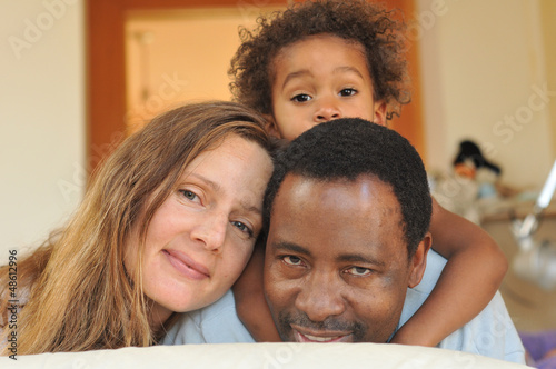 Mixed race family enjoying each other
