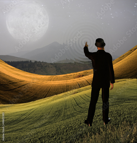 Man touches sky in landscape creating ripples in the scene
