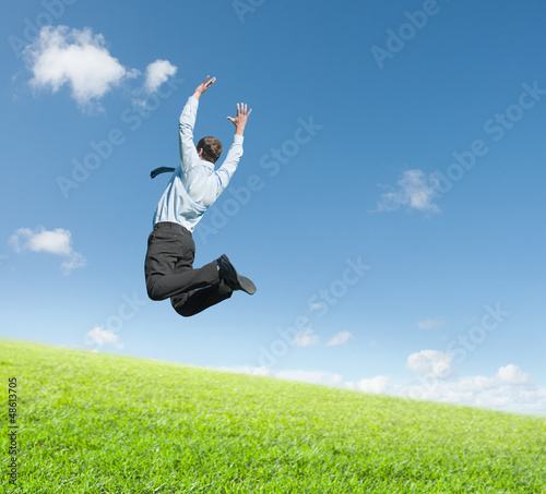 man jumping on  meadow