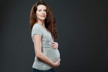 Young expecting mother with long dark hair.