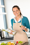 Smiling woman cooking kitchen recipe vegetables home poster