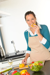 Young woman tasting preparing kitchen vegetables dinner
