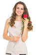 Happy young woman with red rose