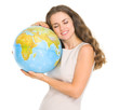 Happy young woman hugging globe