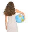 Smiling young woman holding globe. Rear view