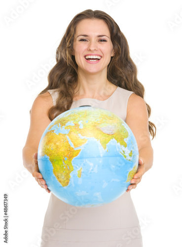 Happy young woman giving globe