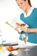 Woman reading recipe cooking book kitchen salad