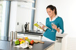 Woman housewife reading cooking book recipe kitchen