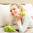 Happy smiling woman with apples