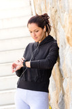 Young woman checking after exercising sport sweatsuit