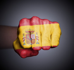 Front view of punching fist on gray background
