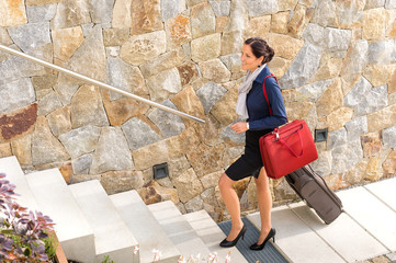 Smiling woman business going traveling baggage leaving