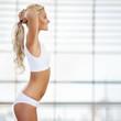 Slim tanned woman's figure.