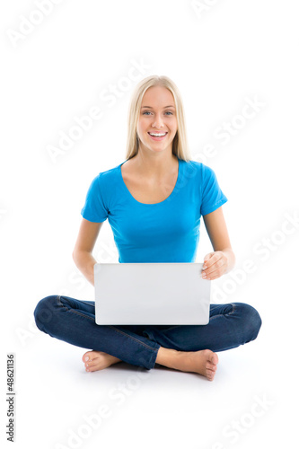 Portrait of a happy young girl with laptop computer