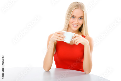 Young beautiful woman with a cup tea