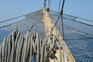 sailing rops on old boat. Bowsprit of a sailing frigate
