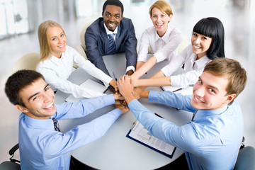 Business team making pile of hands on working place