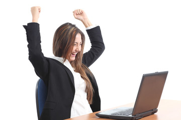 Euphoric business woman watching a laptop
