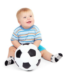 Little boy playing with soccer-ball, isolated on white.