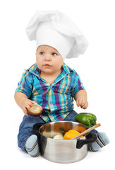 Little boy in chef's hat with pan and vegetables, isolated