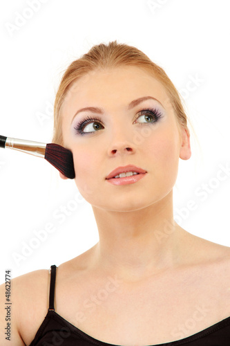 portrait of beautiful woman   with make-up brush for powder,