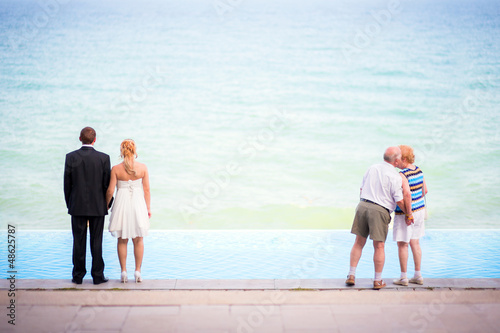 Just married and senior couples on the beach