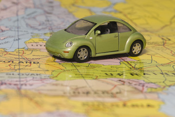Close-up of a toy car on the world map