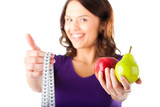 Woman with apple, pear and measuring tape