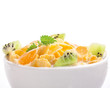 Cornflakes with fruits in bowl isolated on white background