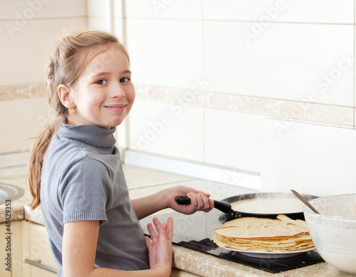 Girl cooking breakfast