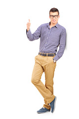 Full length portrait of a young man giving a thumb up