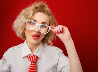 Amazedly woman  wearing eyeglasses and looking you