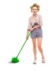 Funny angry or unhappy housewife / girl with broom