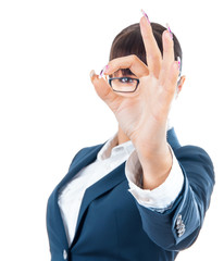 Successful businesswoman showing sign excellent with her fingers