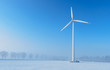 Giant wind turbine in a winter landscape
