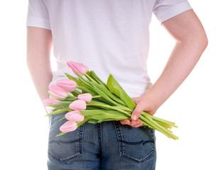 Blumen hinter dem Rücken versteckt