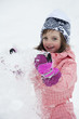 little girl playing with snow - winter
