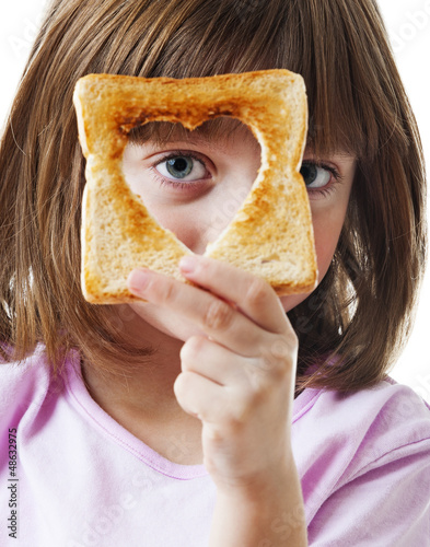 little girl with slice of bread
