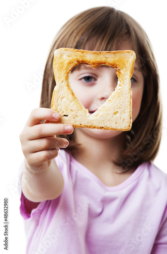 little girl looking through  bread - white background