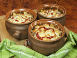Meat and vegetables with cheese and ketchup  in pots