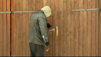 Robber near the garage door