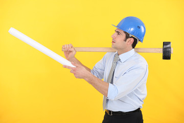 Architect with  a mallet