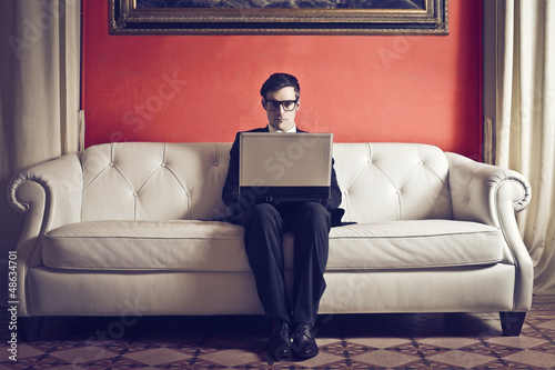 businessman working on sofa