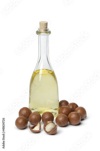 Bottle with Macadamia oil and nuts