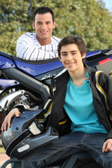 Young men with a motorbike