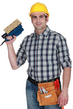 Man with an electric sander poster
