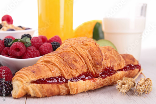 close up on croissant with fruits