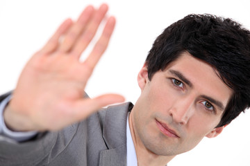 Businessman holding his palm up