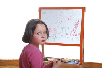 Young girl drawing on the white board
